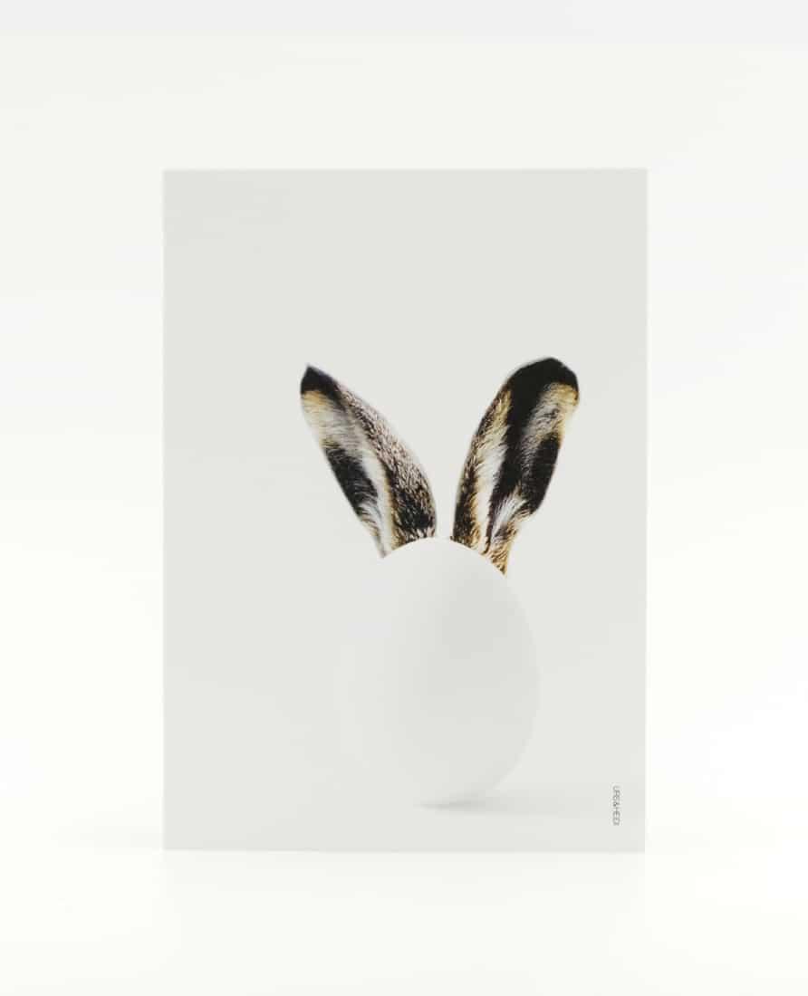 Postkarte zu Ostern mit Ei und Hasenohren