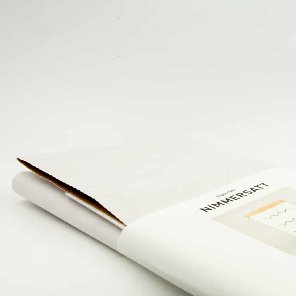 Papiertuete Nimmersatt verpackt mit Banderole